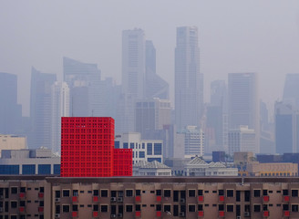 The skyline of the central business district and a public apartment block are seen during haze in Singapore