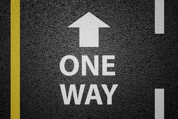 One way sign on asphalt ground