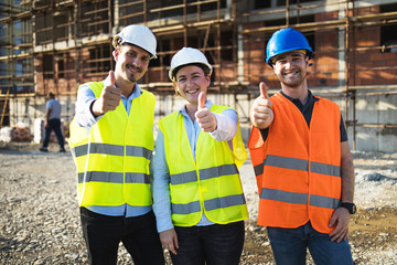 Three construction workers having meeting,pose for the photographer,stock photo