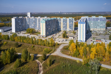 Bird's-eye aerial view on autumn town with modern residential buildings. Novosibirsk, Siberia, Russia.