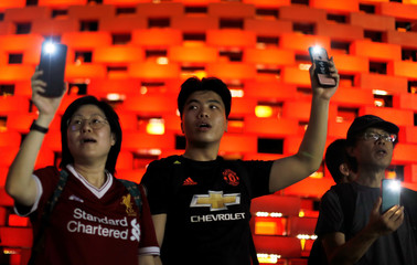 Anti-government protesters wearing Premier League soccer t-shirts stage a protest at Victoria Park in Hong Kong