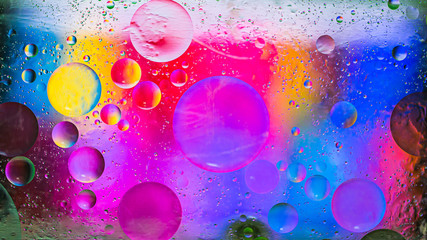Colorful artistic image of oil drop on water for modern and creation design background.
