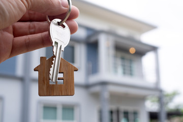 Landlord unlocks the house key for new home.  Real Estate Agents, Sales Agents concept.