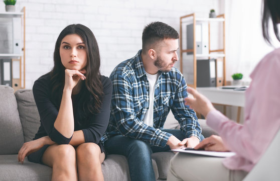 Grumpy couple at marital therapist in office, free space