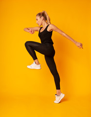 Fitness Girl Jumping During Cardio Workout, Studio Shot