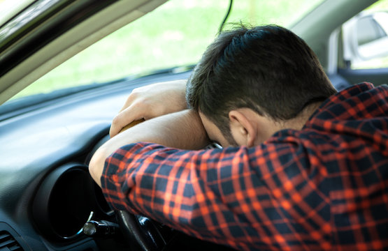 tired driver sleeping while driving a car