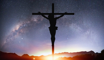Beautiful night landscape with silhouette of Jesus on the cross on the background Milky way galaxy