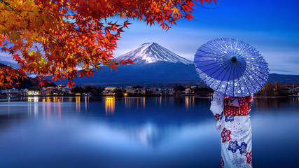 Wall Mural - Asian woman wearing japanese traditional kimono at Fuji mountain in autumn, Kawaguchiko lake in Japan.