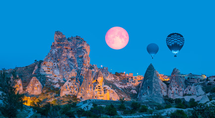 "Pigeon Valley with Uchisar castle with moon - Hot air balloon flying over spectacular Cappadocia ""Elements of this image furnished by NASA """