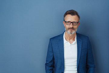 Serious businessman wearing glasses staring