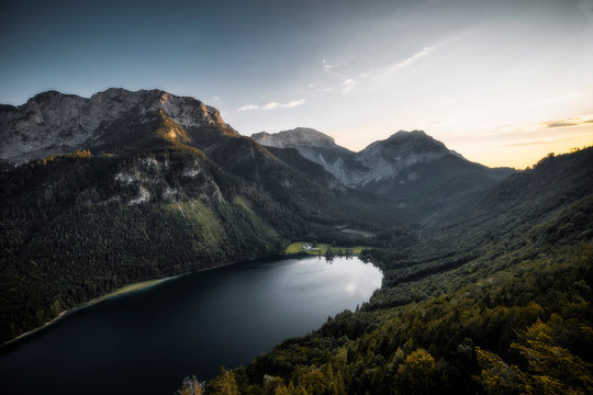Aerial photography of lake beside mountain during daytime