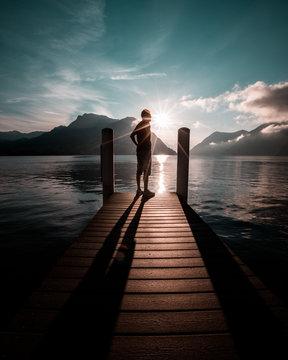 man standing on wooden dock