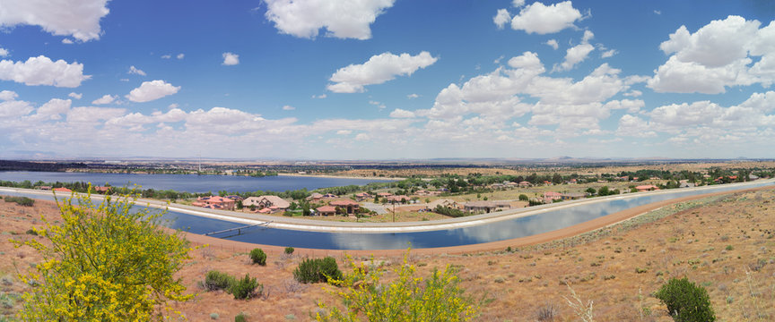 Panoramic image looking east of Palmdale in Los Angeles county showing the California aqueduct in the foreground.