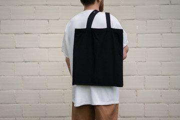 Man holding cotton Black Tote bag