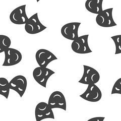 Vector Image Theatrical face mask. Drama and comedy icon seamless pattern on a white background.
