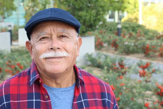 Senior Hispanic man outdoor headshot