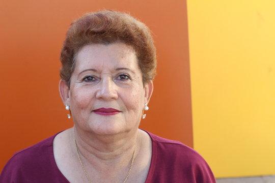 Senior retired woman looking at camera