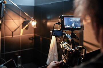 Behind the scenes of filming movies and video products, setting up equipment for shooting video and sound. The concept of producing video content for social networks, TV and blogs.