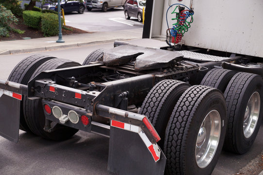Rear of the tractor unit. Visible fifth wheel couplings are fitted to a tractor unit to connect it to the trailer.