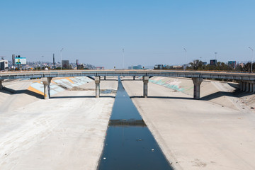 The Tijuana River canal, which often serves as the location of homeless encampments of individuals deported from the United States.