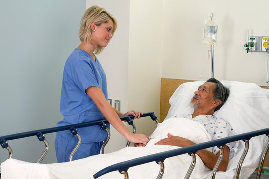 Medical Professional Comforting Elderly Asian Patient