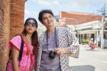 thai couple sightseeing around chiang mai old city wall