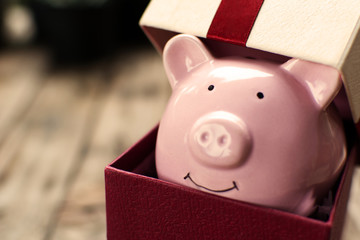 Piggy bank in the gift box celebration on holiday concept.
