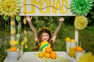 Young girl near lemonade stand in park