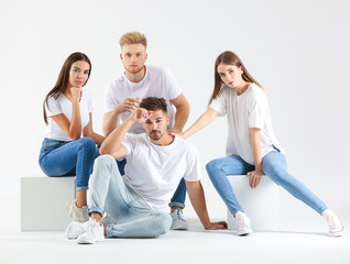 Group of young people in stylish casual clothes on white background