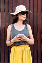 Beautiful caucasian woman using mobile in the street