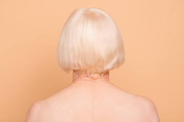 Rear back behind view close-up portrait of her she nice attractive groomed gray-haired lady after applying mask balm wrap natural oil isolated over beige pastel background