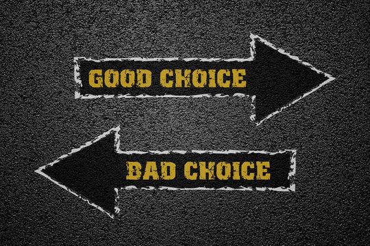 Good and bad choice concept on asphalt ground
