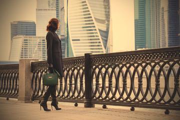 woman in a dark coat