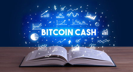 BITCOIN CASH inscription coming out from an open book, business concept