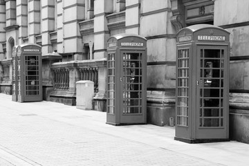 Great Britain telephone booths. Black and white vintage style.