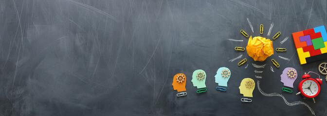 Obraz Education concept image. Creative idea and innovation. Crumpled paper as light bulb metaphor over blackboard - fototapety do salonu