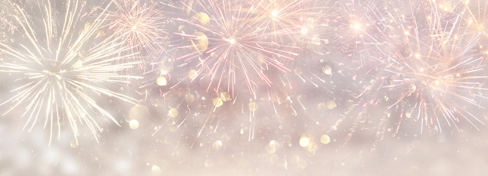 abstract gold and silver glitter background with fireworks. christmas eve, 4th of july holiday concept. banner