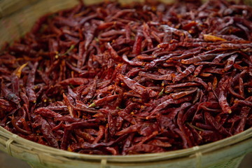 heap of dry chili vegetable in market .