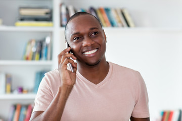 African american bald headed mature man at phone