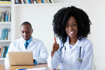 Laughing medical student with general practitioner