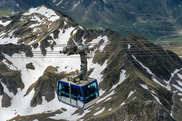 A gondola lift ascends to the observatory on the pic du Midi de Bigorre mountain, in the Pyrenees Mountains (France).