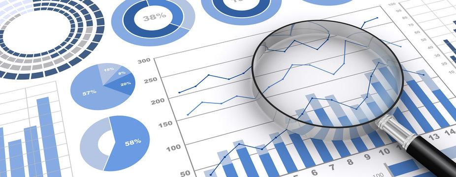 ビジネス資料と虫眼鏡