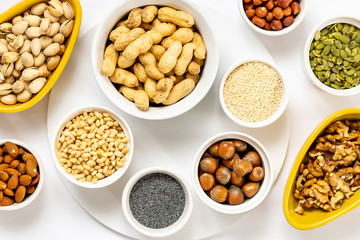 Various Nuts and Seeds on White Background in the Bowls - Image