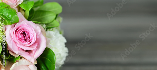 Mothers Day background. Bouquet of flowers on wooden background with copy space