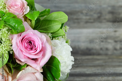 Mothers Day card with bouquet of flowers on wooden background