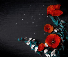 Fototapete - Bouquet of red poppies and white Spiraea on a black background. Wild flowers.