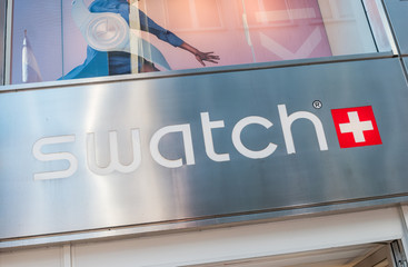 COLOGNE, GERMANY OCTOBER, 2017: Swatch watch store sign on a store. Swatch is a Swiss watchmaker founded in 1983 by Nicolas Hayek, and is subsidiary of The Swatch Group.
