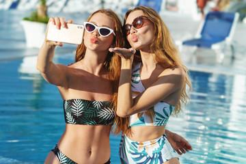 Two beautiful sexy young girls wearing swimwear standing