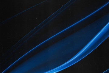 A real wisp of blue smoke on a black background with grain, dust and scratches overlay that makes an abstract artistic retro background