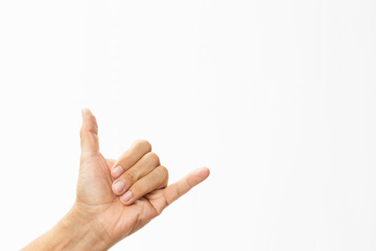 male hand doing a Shaka sign isolate on white background